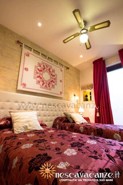 Camera con letti singoli trasformabili in matrimoniale casa pescoluse 6