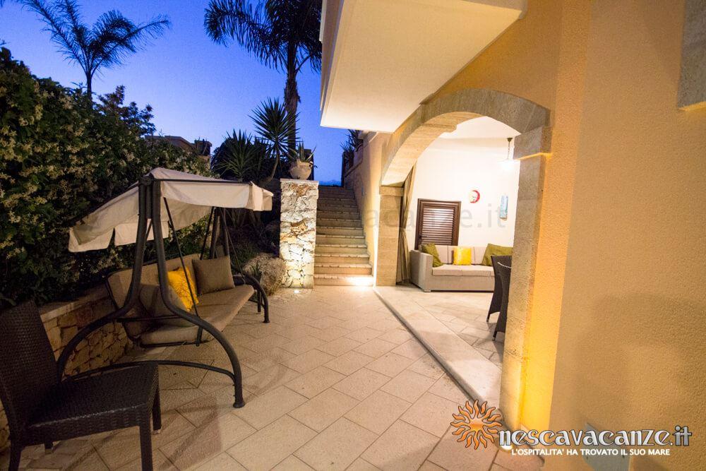Veranda attrezzata di notte casa Pescoluse 6