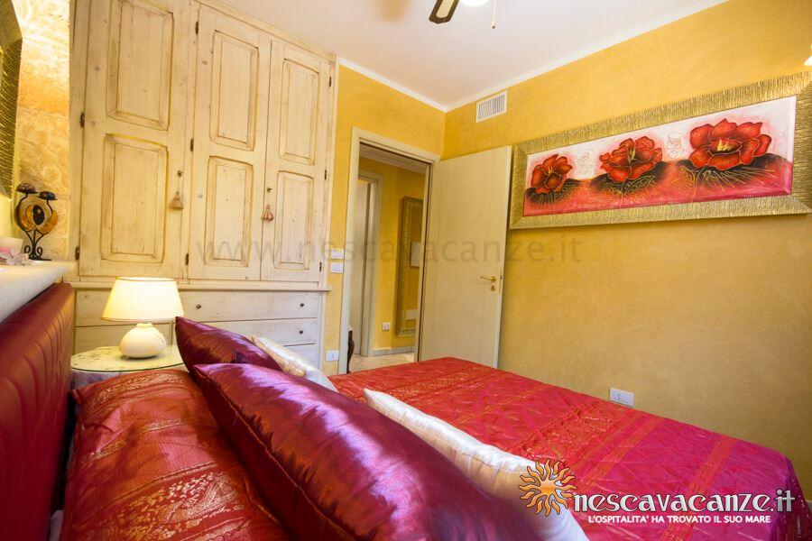 Camera con letti singoli trasformabili in matrimoniale casa pescoluse 7