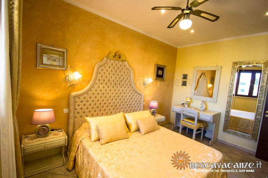 Camera con letti singoli trasformabili in matrimoniale casa pescoluse 8